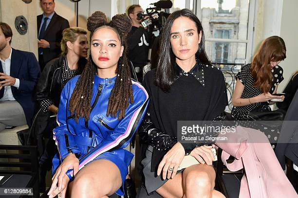 Sasha Lane and Jennifer Connelly attend the Louis Vuitton show as part of the Paris Fashion Week Womenswear Spring/Summer 2017 on October 5 2016 in...