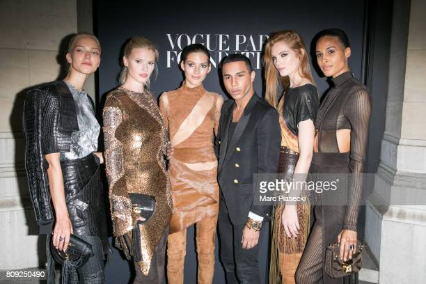 Sasha Lush Lara Stone Valery Kaufman Olivier Rousteing Alexina Graham and Cindy Bruna attend Vogue Foundation Dinner during Paris Fashion Week as...