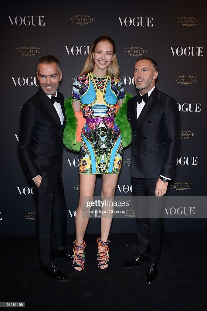 Sasha Luss (C), Dean Caten and Dan Caten attend the Vogue 95th Anniversary Party : Photocall as part of the Paris Fashion Week Womenswear Spring/Summer 2016 on October 3, 2015 in Paris, France.