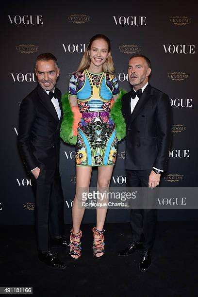 Sasha Luss Dean Caten and Dan Caten attend the Vogue 95th Anniversary Party Photocall as part of the Paris Fashion Week Womenswear Spring/Summer 2016...