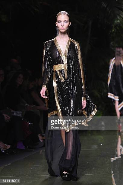 Sasha Luss walks the runway during the Balmain show as part of the Paris Fashion Week Womenswear Spring/Summer 2017 on September 29 2016 in Paris...