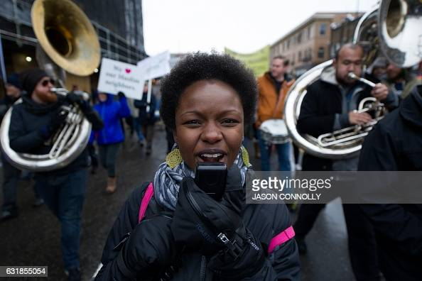 TOPSHOT Sasha McGhee of the band No Enemies sings while marching down Colfax Avenue during Denver's Martin Luther King Jr parade on January 2017...