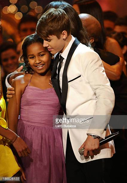 Sasha Obama and Justin Bieber pose onstage onstage during Christmas in Washington 2011 at the National Building Museum on December 11 2011 in...