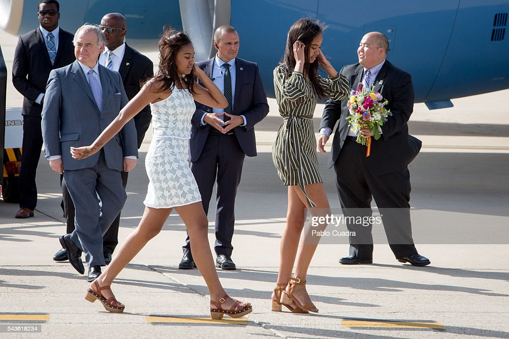 <a gi-track='captionPersonalityLinkClicked' href=/galleries/search?phrase=Sasha+Obama&family=editorial&specificpeople=2631619 ng-click='$event.stopPropagation()'>Sasha Obama</a> and <a gi-track='captionPersonalityLinkClicked' href=/galleries/search?phrase=Malia+Obama&family=editorial&specificpeople=2631620 ng-click='$event.stopPropagation()'>Malia Obama</a> arrive at Torrejon Air Force Base on June 29, 2016 in Madrid. The First Lady will deliver a speech on Let Girls Learn to girls and young women, sharing the stories of girls she has met in her prior travels and highlighting new commitments to support Let Girls Learn. Mrs. Obama will encourage the audience to value their own educational opportunities, continue to strive for progress for girls and young women in their country, and take action to help the more than 62 million girls around the world who are out of school, 2016 in Madrid, Spain.