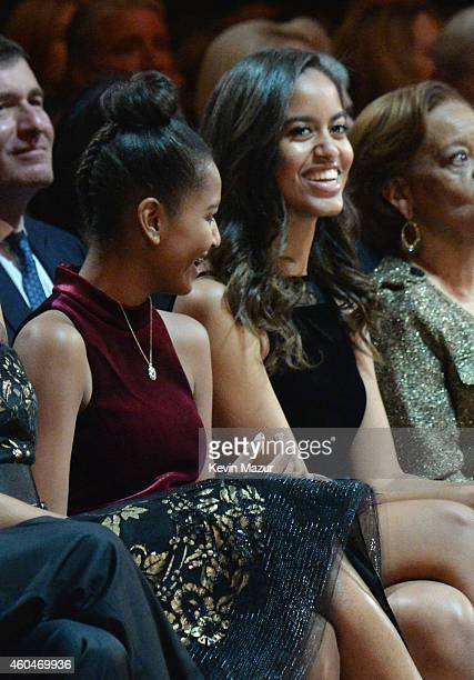Sasha Obama and Malia Obama attend TNT Christmas in Washington 2014 at the National Building Museum on December 14 2014 in Washington DC...