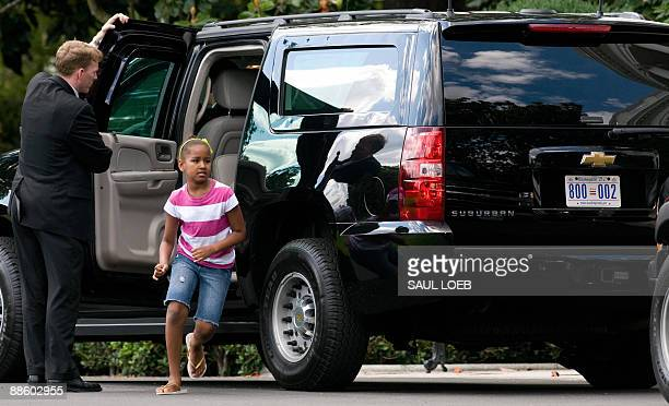 Sasha Obama daughter of US President Barack Obama gets out of an SUV after returning to the White House in Washington following an unscheduled outing...