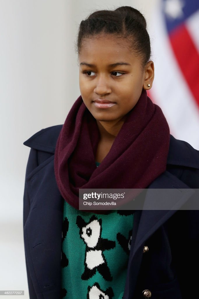 Sasha Obama, 12, participates in the pardoning the 2013 National Thanksgiving Turkey, 'Popcorn' with her father U.S. President Barack Obama on the North Portico of the White House November 27, 2013 in Washington, DC. A 38-pound, full-grown Broad Breasted White domesticated turkey, 'Popcorn' and its alternate 'Caramel' will be sent to live at Mount Vernon, the estate and home of George Washington.