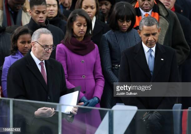 Sasha Obama US Sen Charles Schumer Malia Obama First lady Michelle Obama and US President Barack Obama bow their heads during the presidential...
