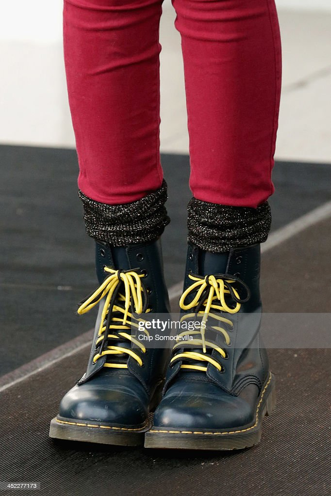 Sasha Obama, 12, wears a pair of dark green boots with lime green laces while participating in the pardoning the 2013 National Thanksgiving Turkey, 'Popcorn' with her father U.S. President Barack Obama on the North Portico of the White House November 27, 2013 in Washington, DC. A 38-pound, full-grown Broad Breasted White domesticated turkey, 'Popcorn' and its alternate 'Caramel' will be sent to live at Mount Vernon, the estate and home of George Washington.