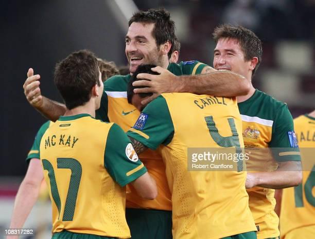 Sasha Ognenovski of Australia celebrates his goal with teammates during the AFC Asian Cup Semi Final match between Uzbekistan and the Australian...