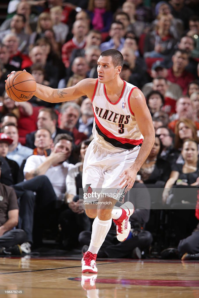 Sasha Pavlovic #3 of the Portland Trail Blazers dribbles the ball up court against the San Antonio Spurs on December 13, 2012 at the Rose Garden Arena in Portland, Oregon.