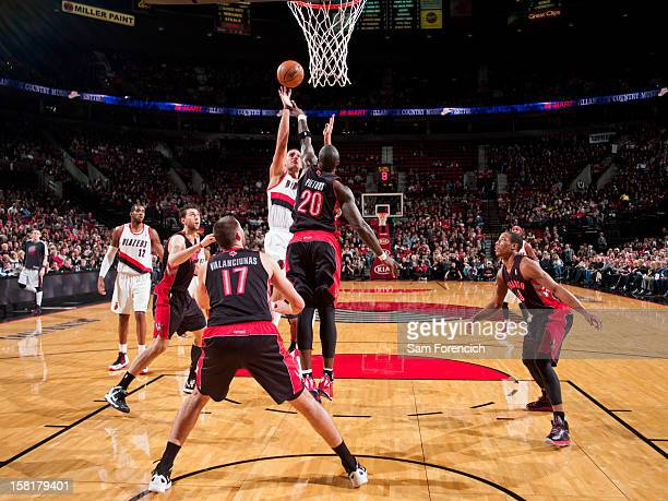 Sasha Pavlovic of the Portland Trail Blazers shoots in the lane against Mickael Pietrus of the Toronto Raptors on December 10 2012 at the Rose Garden...