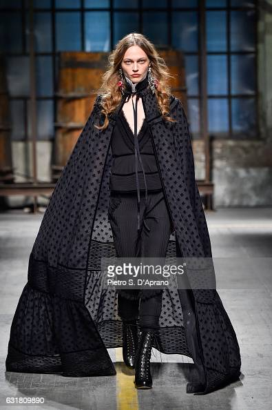 Sasha Pivovarova walks the runway at the Dsquared2 show during Milan Men's Fashion Week Fall/Winter 2017/18 on January 15 2017 in Milan Italy