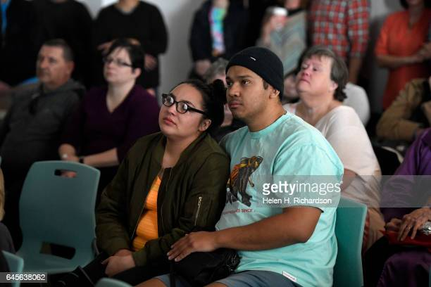 Sasha Strong and her husband Israel Dominguez tearfully watch a video during a celebration of life for Ashley Mead at the Boulder Public Library on...