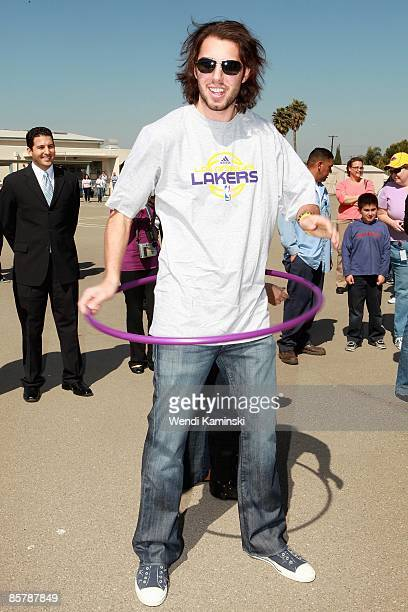 Sasha Vujacic of the Los Angeles Lakers hula hoops during Anthem Blue Cross's 'Fit for Life' nutrition campaign on March 16 2009 at Mark Twain...