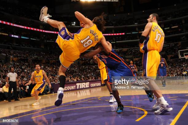 Sasha Vujacic of the Los Angeles Lakers loses his balance against Al Harrington of the New York Knicks at Staples Center on December 16 2008 in Los...