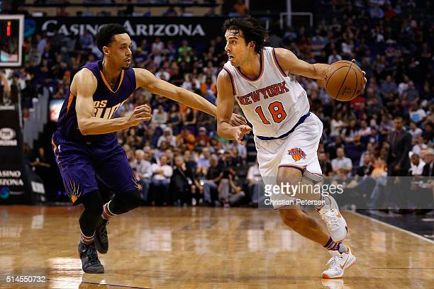 Sasha Vujacic of the New York Knicks drives the ball past John Jenkins of the Phoenix Suns during the first half of the NBA game at Talking Stick...