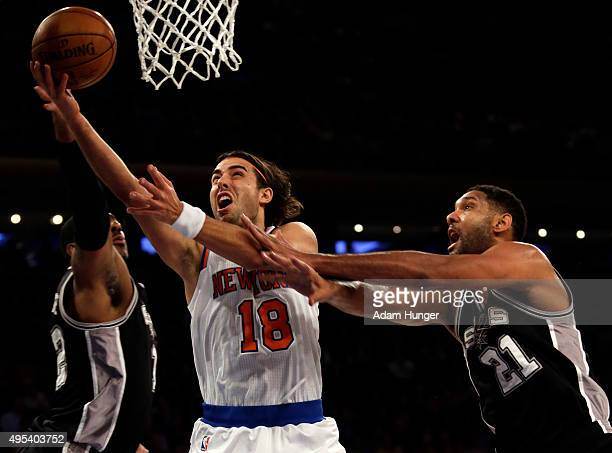 Sasha Vujacic of the New York Knicks drives to the basket past Tim Duncan of the San Antonio Spurs during the first quarter at Madison Square Garden...