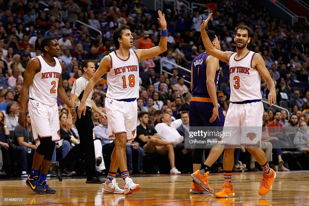 Sasha Vujacic #18 of the New York Knicks high-fives Jose Calderon #3 after scoring against the Phoenix Suns during the first half of the NBA game at Talking Stick Resort Arena on March 9, 2016 in Phoenix, Arizona.