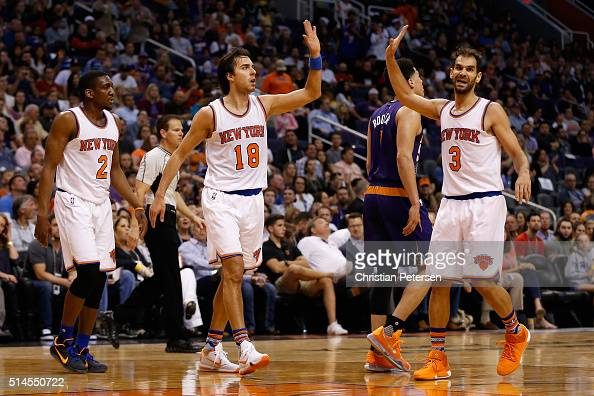 Sasha Vujacic of the New York Knicks highfives Jose Calderon after scoring against the Phoenix Suns during the first half of the NBA game at Talking...