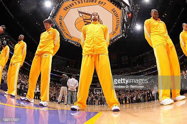 Sasha Vujacic Pau Gasol and Andrew Bynum of the Los Angeles Lakers stand for the national anthem before the game against the Phoenix Suns in Game One...