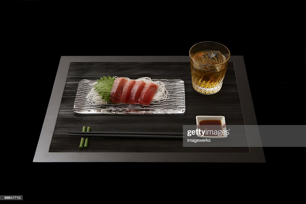 Sashimi on plate with whisky on table : Stock Photo