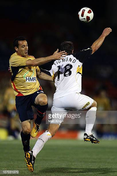 Sasho Petrovski of the Jets clashes with Ben Sigmund of the Phoenix during the round 15 ALeague match between the Newcastle Jets and the Wellington...