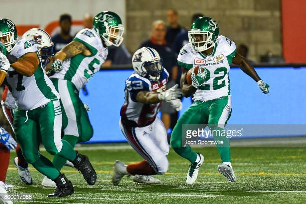 Saskatchewan Roughriders running back Greg Morris avoiding contact with Montreal Alouettes linebacker Frederic Plesius during the Saskatchewan...