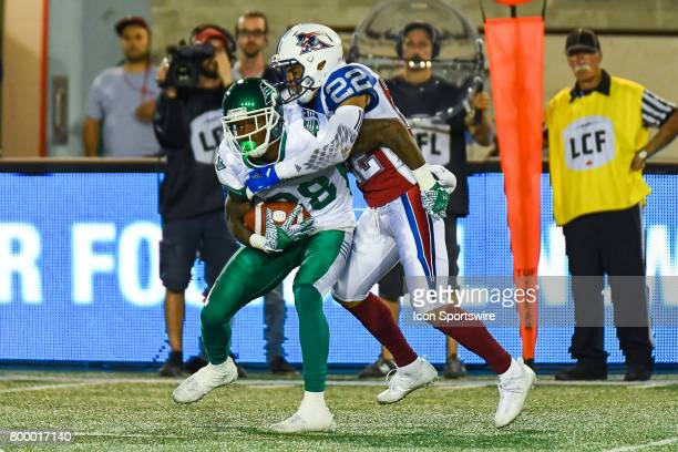 Saskatchewan Roughriders wide receiver Caleb Holley covered by Montreal Alouettes defensive back Greg Henderson during the Saskatchewan Roughriders...