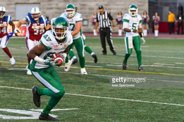 Saskatchewan Roughriders wide receiver Duron Carter holding the ball after receiving it from a pass of Saskatchewan Roughriders quarterback Kevin...