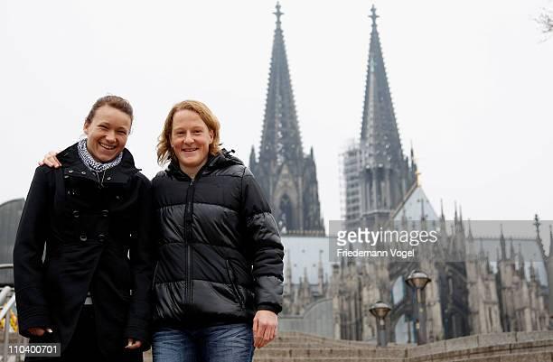 Saskia Bartusiak of 1 FFC Frankfurt and Josephine Henning of 1 FFC Turbine Potsdam pose prior to the Women's DFB Cup 2011 Media Brunch at Historic...