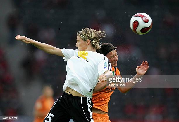 Saskia Bartusiak of Frankfurt and Verena Hagedorn of Duisburg head for the ball during the Women's DFB German Cup final between 1FFC Frankfurt and...
