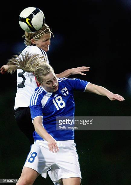 Saskia Bartusiak of Germany and Linda Sallstrom of Finland jump for a header during the Woman's Algarve Cup match between Germany and Finland at the...
