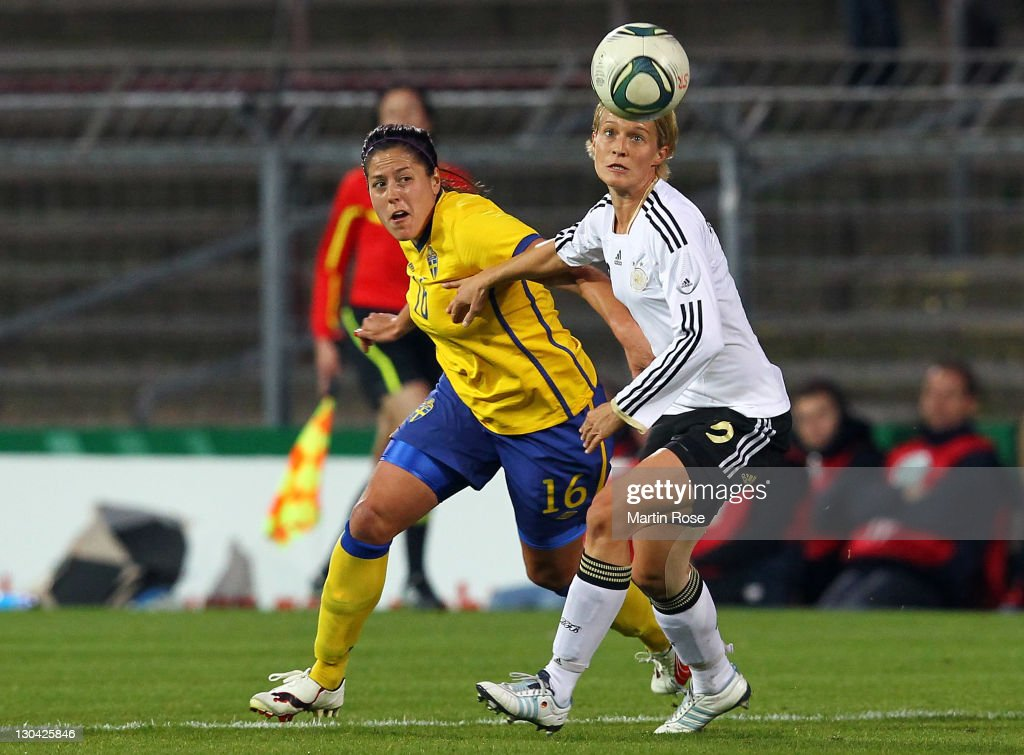 Saskia Bartusiak (R) of Germany and Madelaine Edlund (L) of Sweden battle for the ball during the Women's International friendly match between Germany and Sweden on October 26, 2011 in Hamburg, Germany.