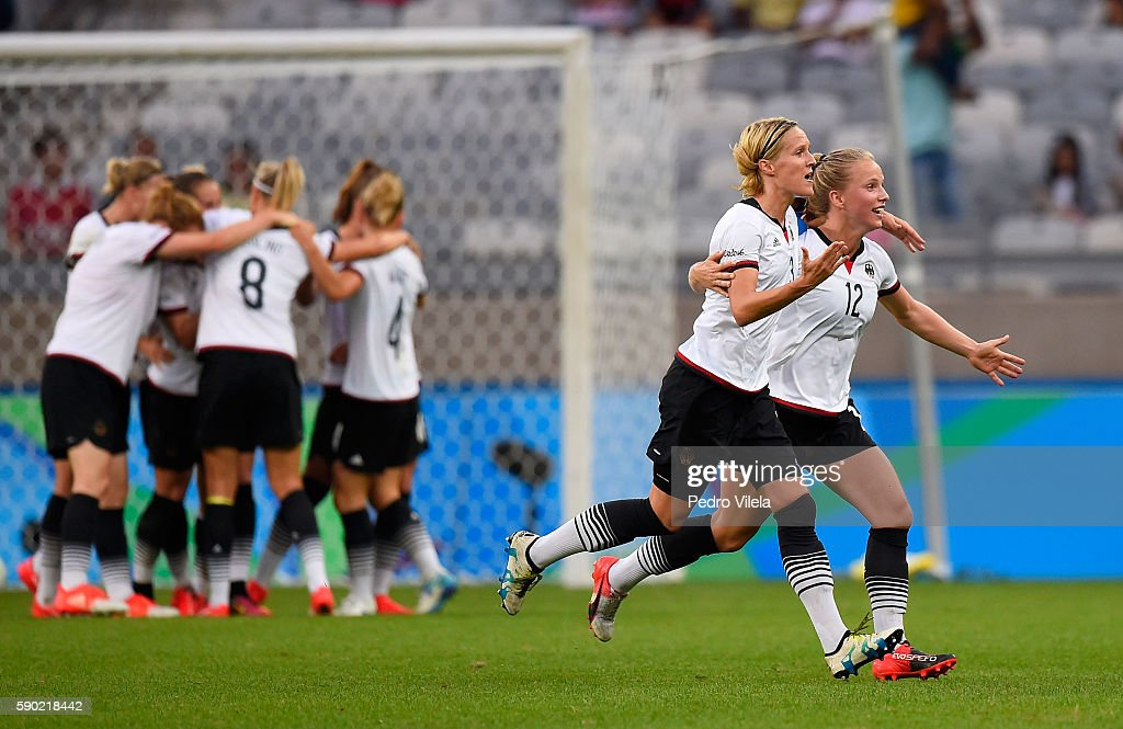 Saskia Bartusiak #3 of Germany and Tabea Kemme #12 of Germany celebate a goal during the Women's Semi Final match between Germany and Canada on Day 11 of the Rio 2016 Olympic Games at Mineirao Stadium on August 16, 2016 in Belo Horizonte, Brazil.