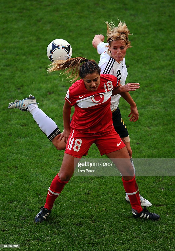 <a gi-track='captionPersonalityLinkClicked' href=/galleries/search?phrase=Saskia+Bartusiak&family=editorial&specificpeople=626898 ng-click='$event.stopPropagation()'>Saskia Bartusiak</a> of Germany challenges Eyluel Elgalp of Turkey during the UEFA Womens Euro 2013 qualification match between Germany and Turkey at Schauinsland-Reisen-Arena on September 19, 2012 in Duisburg, Germany.