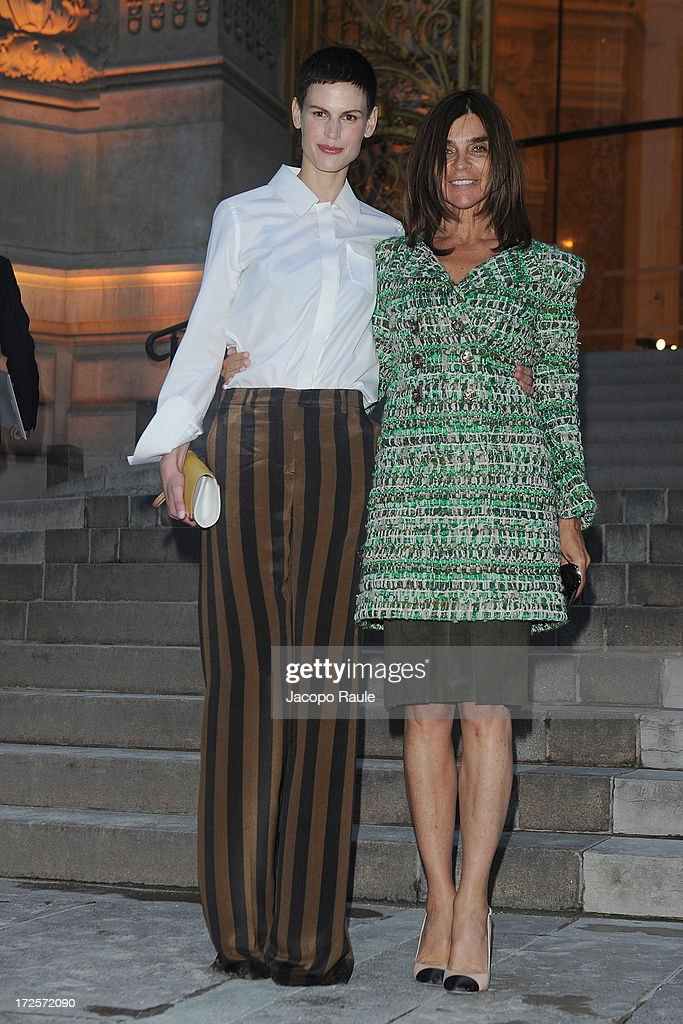 Saskia De Brauw and Carine Roitfeld arrive at 'The Glory Of Water' : Karl Lagerfeld's Exhibition Dinner at Fendi on July 3, 2013 in Paris, France.