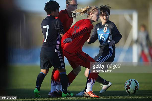 Saskia Matheis of Germany and Yu Nakasato and Mayu Sasaki of Japan fight for the ball during the women's U23 international friendly match between...
