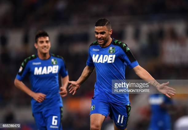 Sassuolo's French forward Gregoire Defrel celebrates after scoring during the italian Serie A football match Roma vs Sassuolo at the Olympic Stadium...