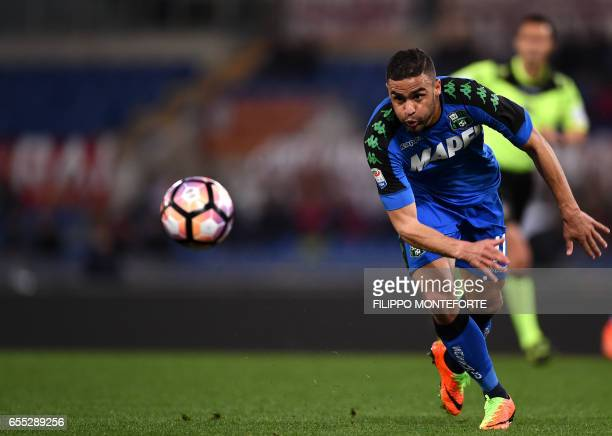 Sassuolo's French forward Gregoire Defrel eyes the ball during the italian Serie A football match Roma vs Sassuolo at the Olympic Stadium in Rome on...