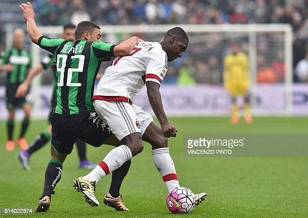 Sassuolo's French forward Gregoire Defrel vies for the ball with AC Milan's Colombian defender Christian Zapata during the Serie A football match...