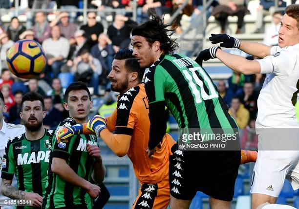 Sassuolo's goalkeeper Andrea Consigli pushes the ball past AC Milan's midfielder Joaquin Fernandez during the Italian Serie A football match between...