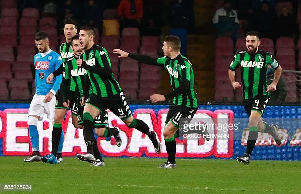 Sassuolo's Italian forward Diego Falcinelli celebrates with teammates after scoring a goal during the Italian Serie A football match Napoli and...