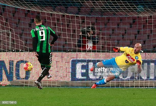 Sassuolo's Italian forward Diego Falcinelli scores a penalty against Napoli's Spanish goalkeeper Pepe Reina during the Italian Serie A football match...