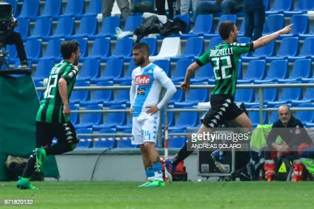 Sassuolo's midfielder from Italy Luca Mazzitelli celebrates after scoring next to Napoli's midfielder from Italy Lorenzo Insigne during the Italian...