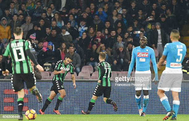 Sassuolos player Gregoire Defrel celebrates after scoring the 11 goal beside the disappointment of Napoli players during the Serie A match between...