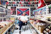 Sat Gupta of Reppa Flags and Souvenirs poses for a photograph in his store which carries the Confederate flag as well as more than 300 other flags...