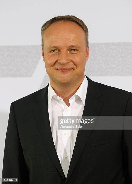 Sat1 presenter Oliver Welke smiles during a photocall on September 10 2009 in Munich Germany He will comment the 2009/2010 Champions League football...