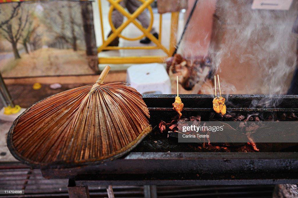Satay barbeque with traditional cooking fan : Stock Photo