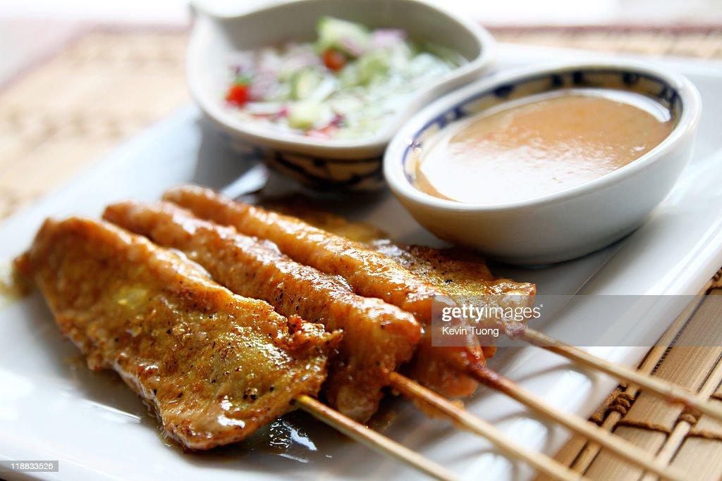 Satay chicken skewers : Stock Photo
